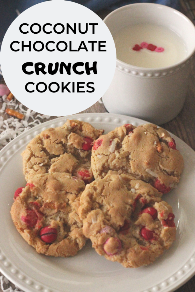 Pinterest image of golden brown cookies with red and white m & ms in them with a glass of milk.