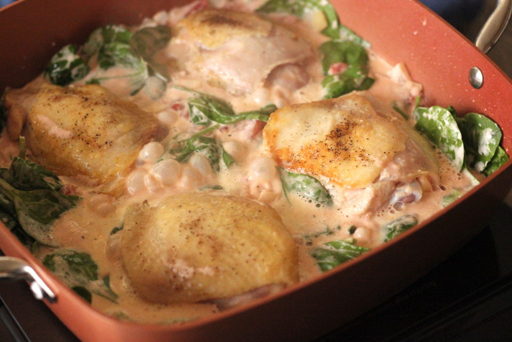 Chicken thighs in a creamy spinach tomato sauce