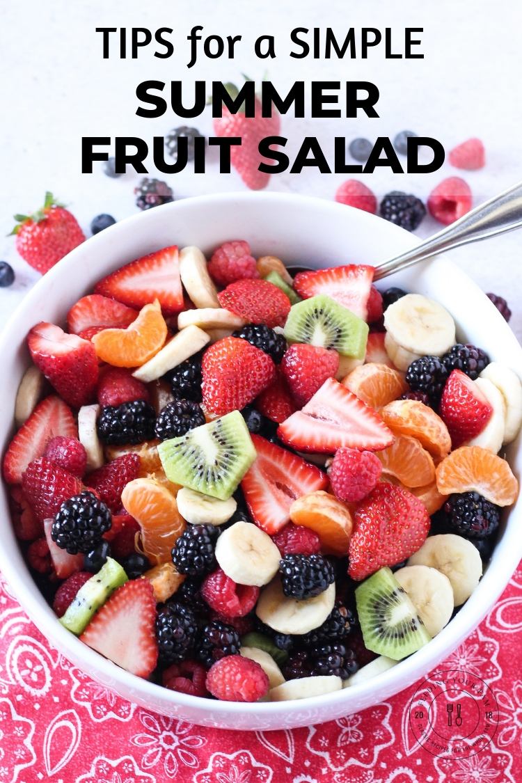 "Big bowl of mixed berry fruit salad with the words ""Tips for a simple summer fruit salad"""