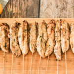 chicken kabobs on a wooden cutting board