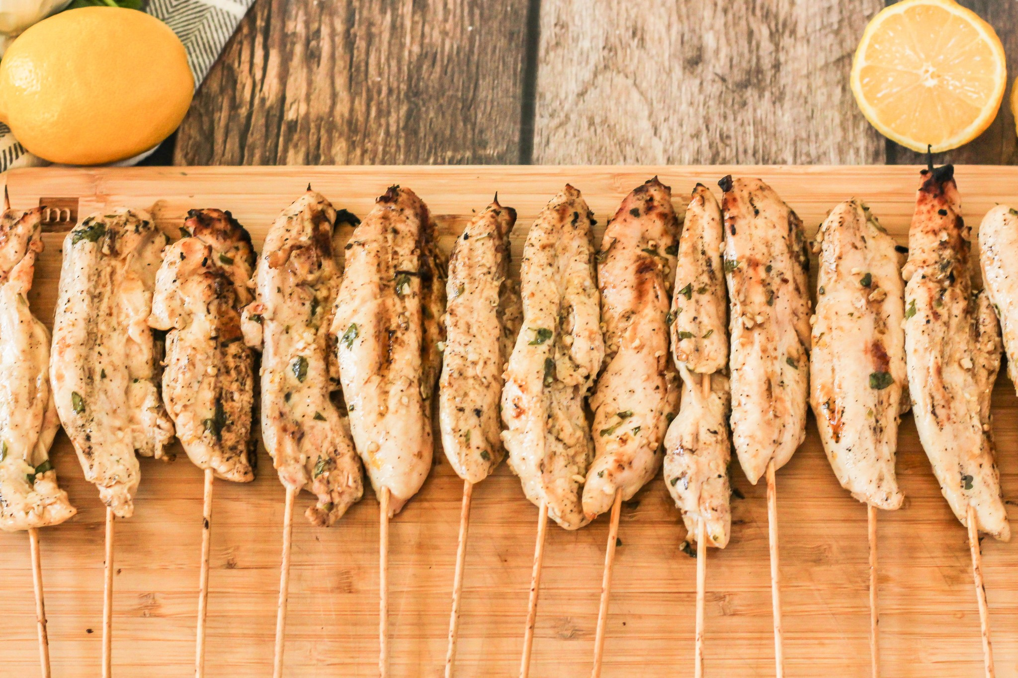 grilled chicken kabobs on a wooden cutting board