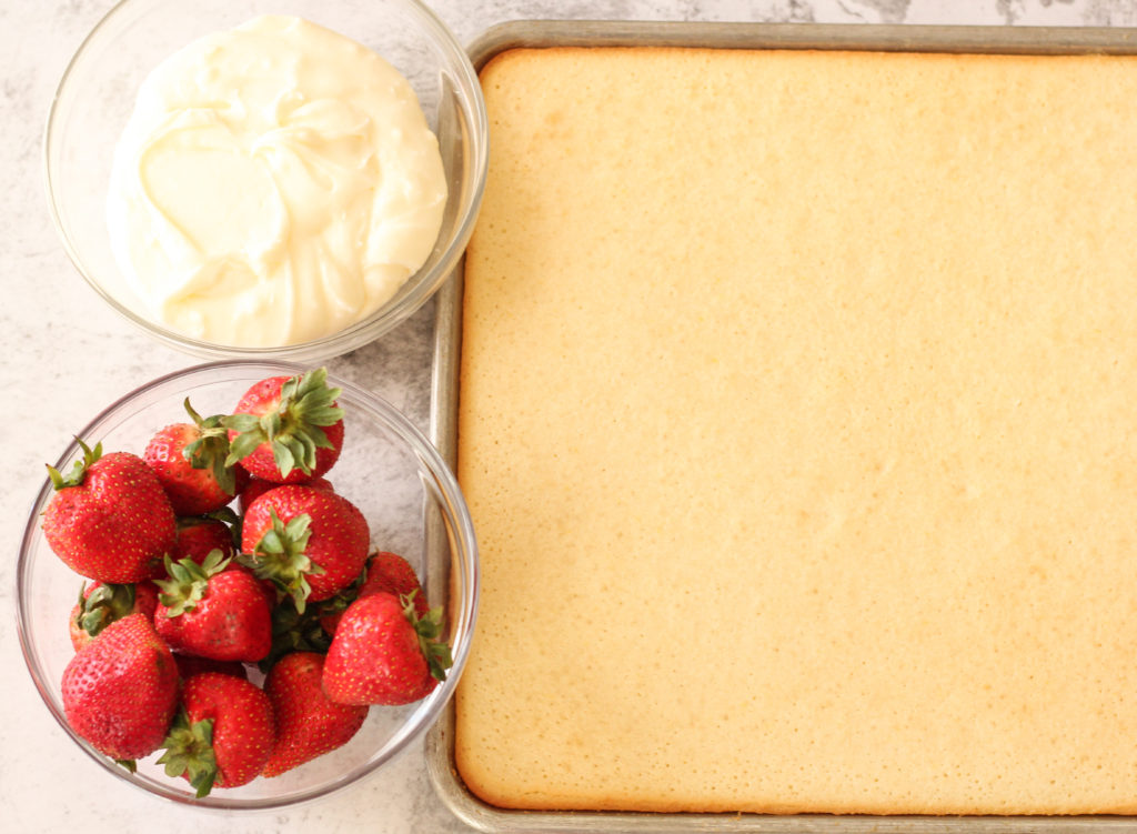 sheet cake and frosting and strawberries