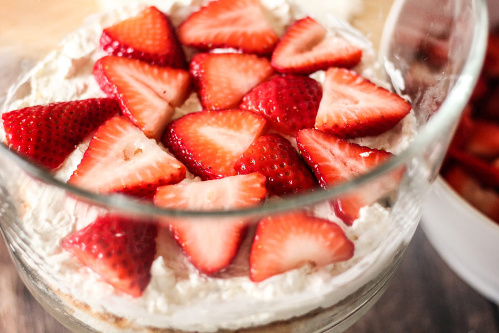 layering strawberries for a trifle