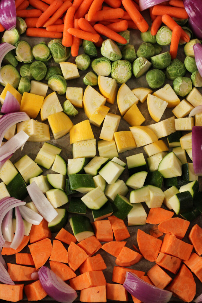 chopped vegetables on a sheet pan