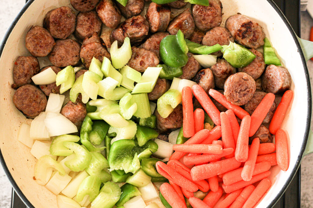 cooking sausage and vegetables