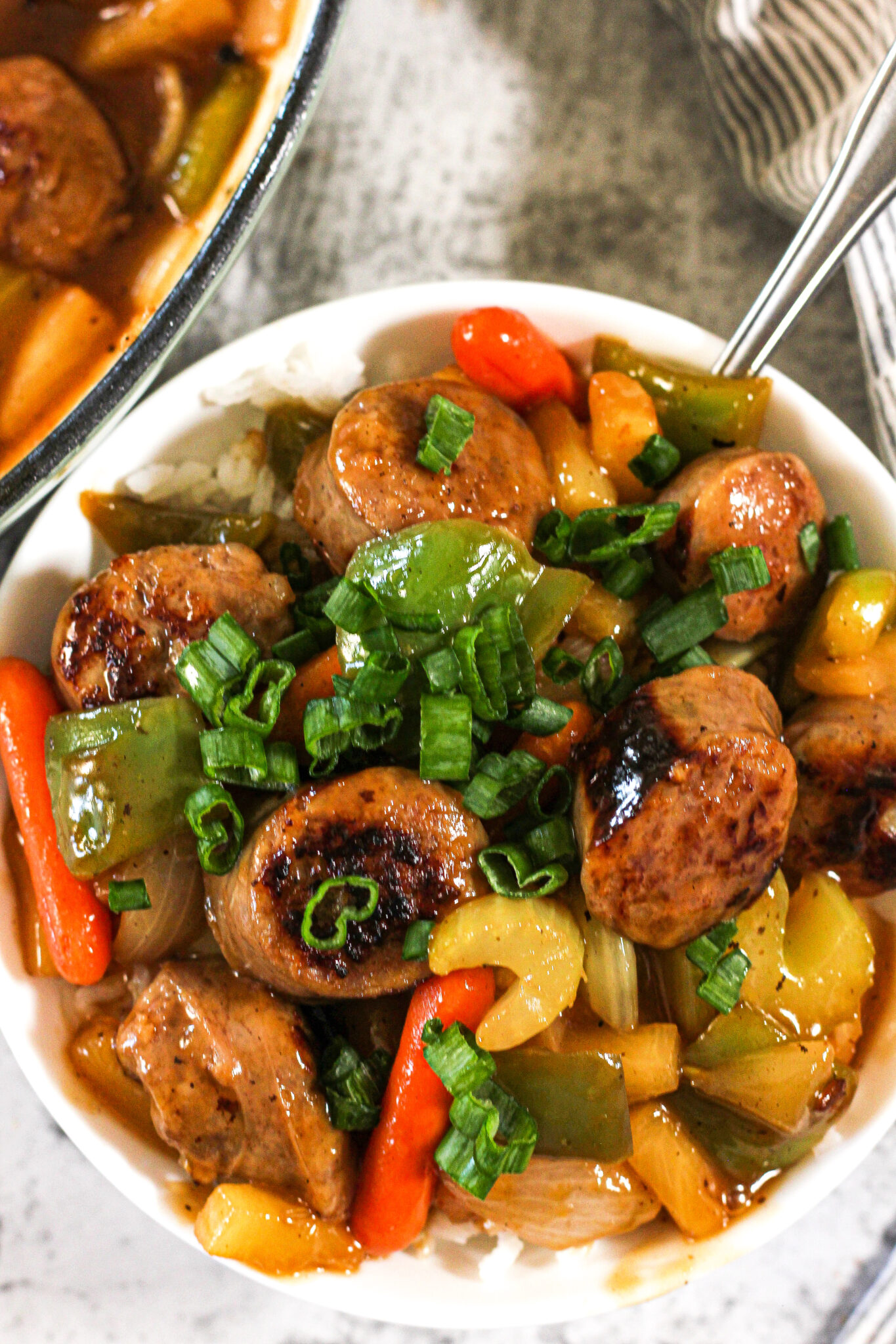 pepper and sausages in sweet and sour sauce