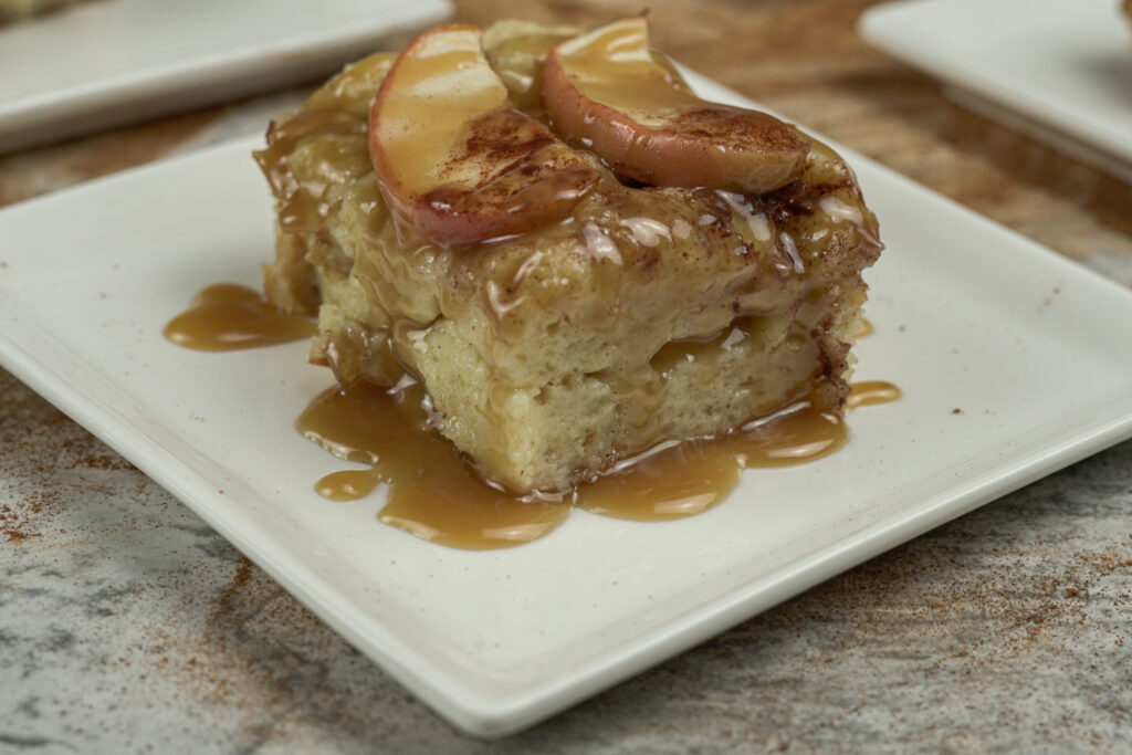 apple bread pudding drizzled in caramel