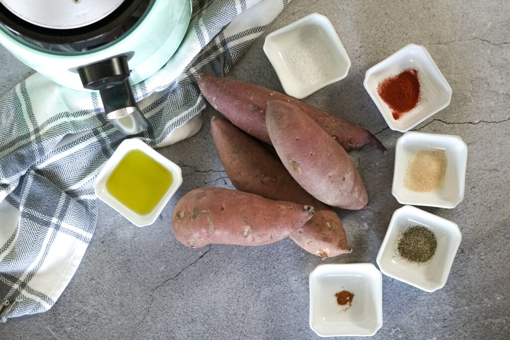 sweet potatoes surrounded by little bowls of spices