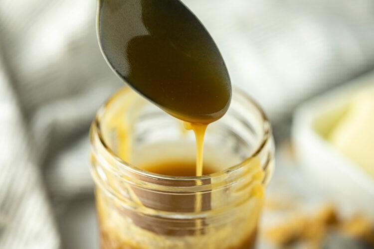 drizzling caramel sauce into jar
