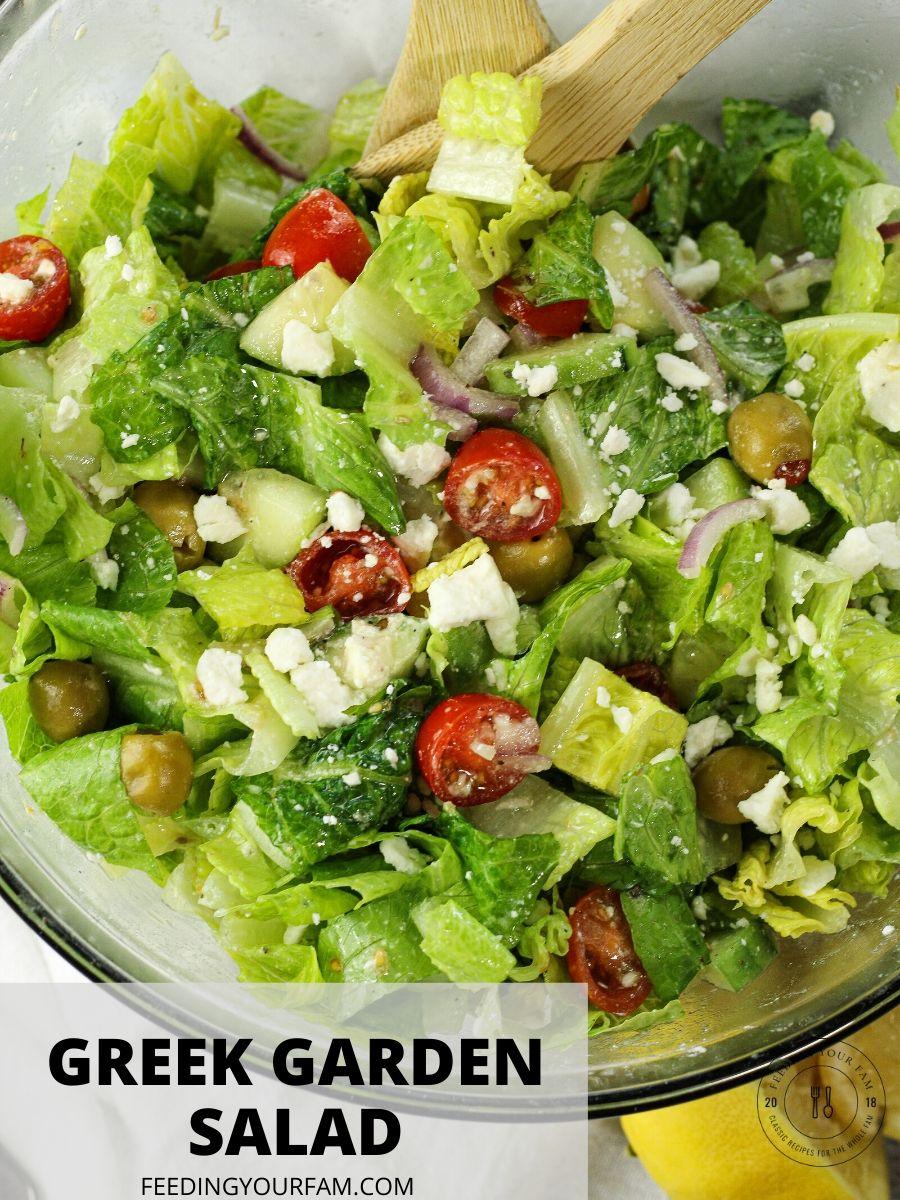 toss greek garden salad in a glass bowl