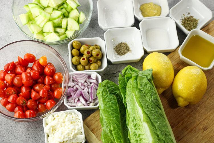 ingredients for greek garden salad in little bowls
