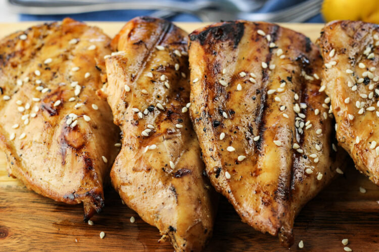 marinaded grilled teriyaki chicken that has been cooked and has sesame seeds on top