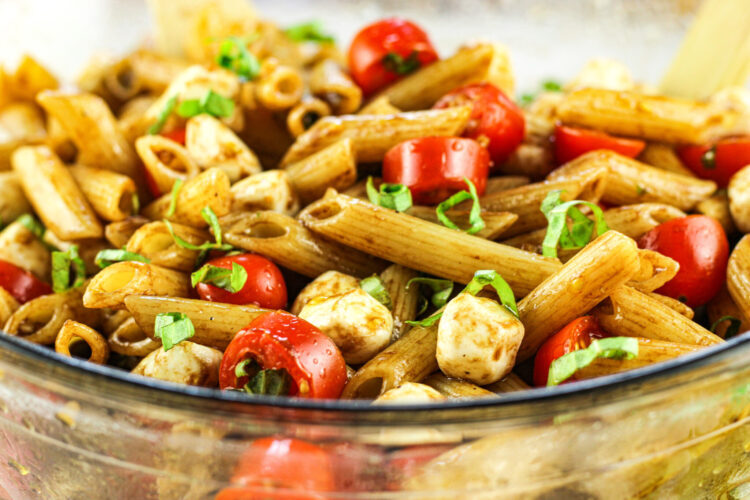 penne pasta with tomatoes, basil and mozzarella pearls
