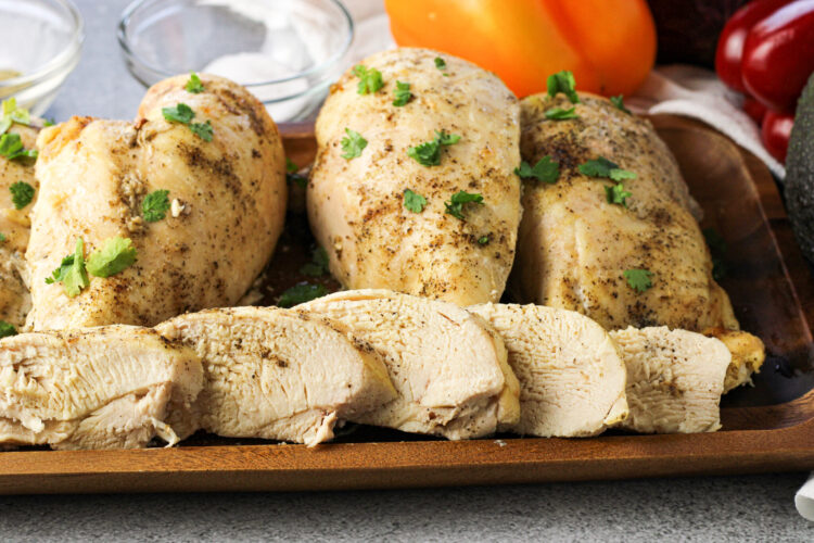 sliced chicken breasts with whole breasts behind