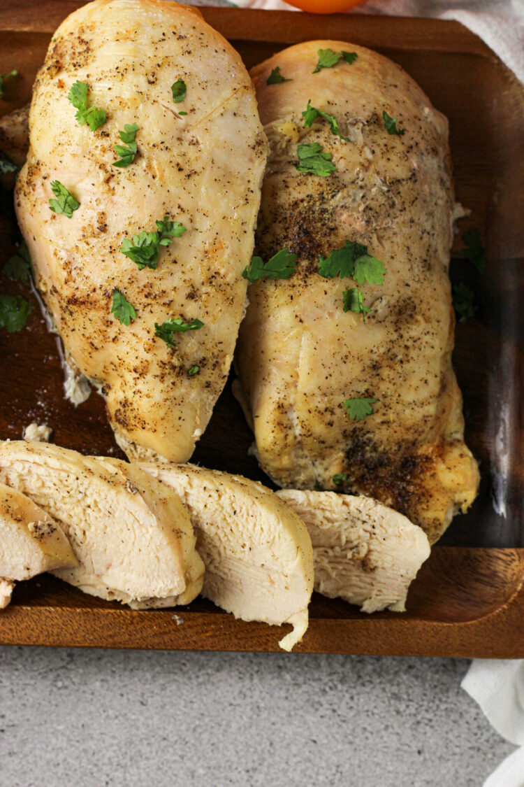 chicken breasts on a wooden platter