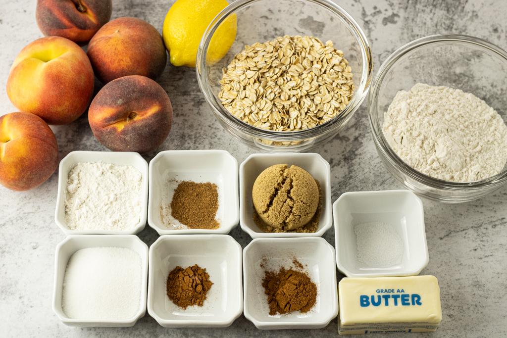 peaches, lemon, oats, flour, cinnamon, nutmeg, brown sugar and a cube of butter to make peach crisp recipe