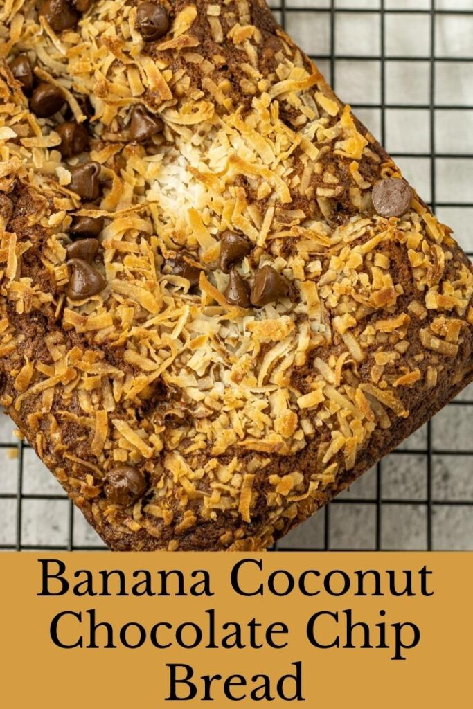 banana bread topped with coconut and chocolate chips on a cooling rack