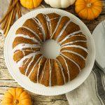pumpkin bundt cake surrounded by small pumpkins