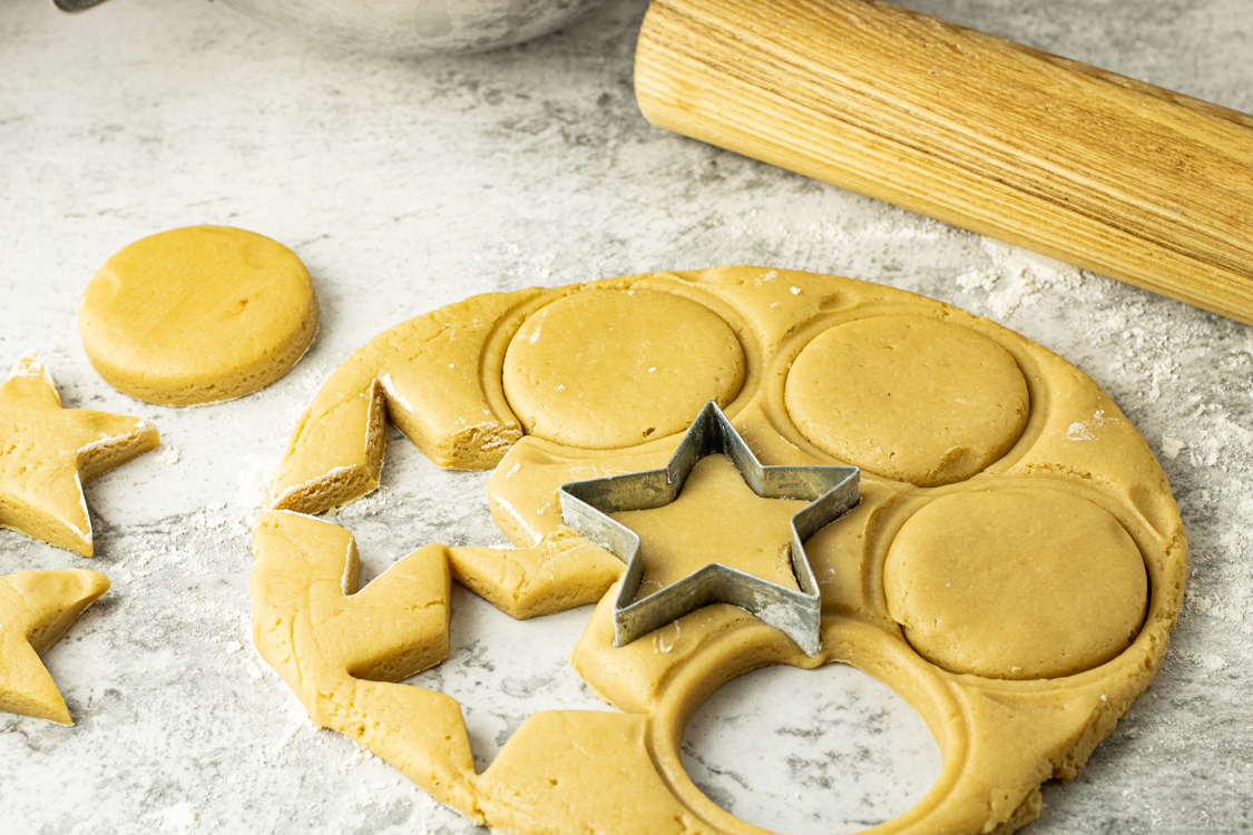 cutting out brown sugar cookies with a cookie cutter