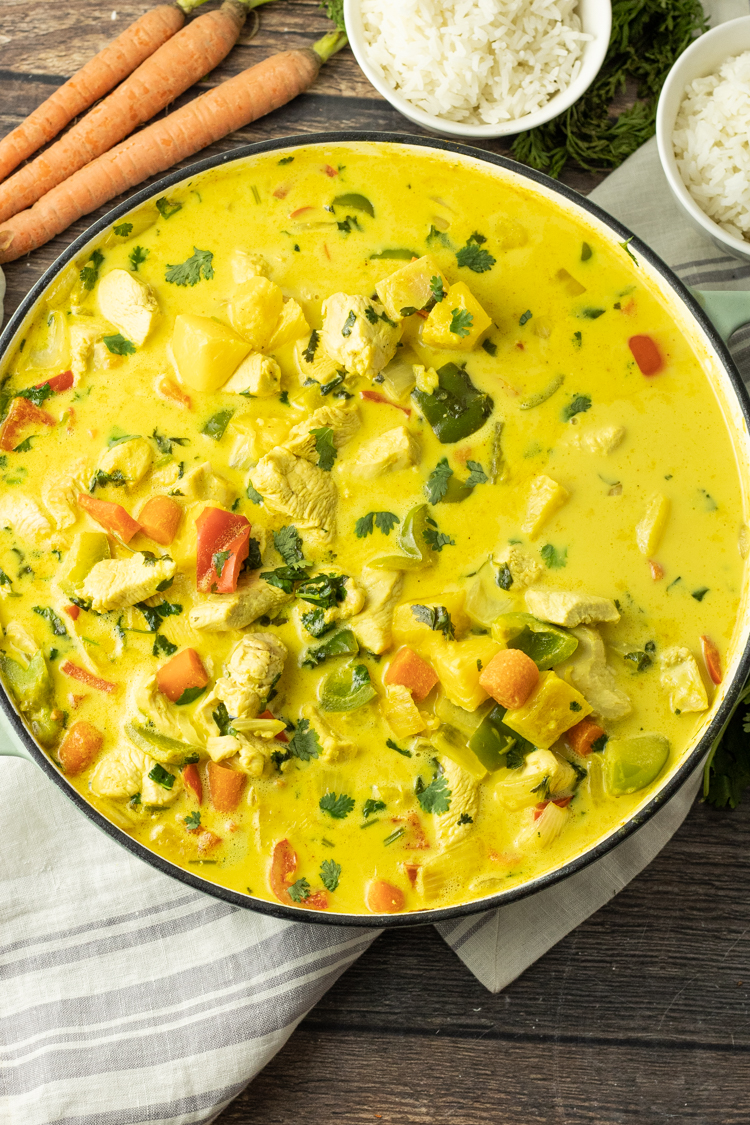 big pot of yellow pineapple curry with chicken
