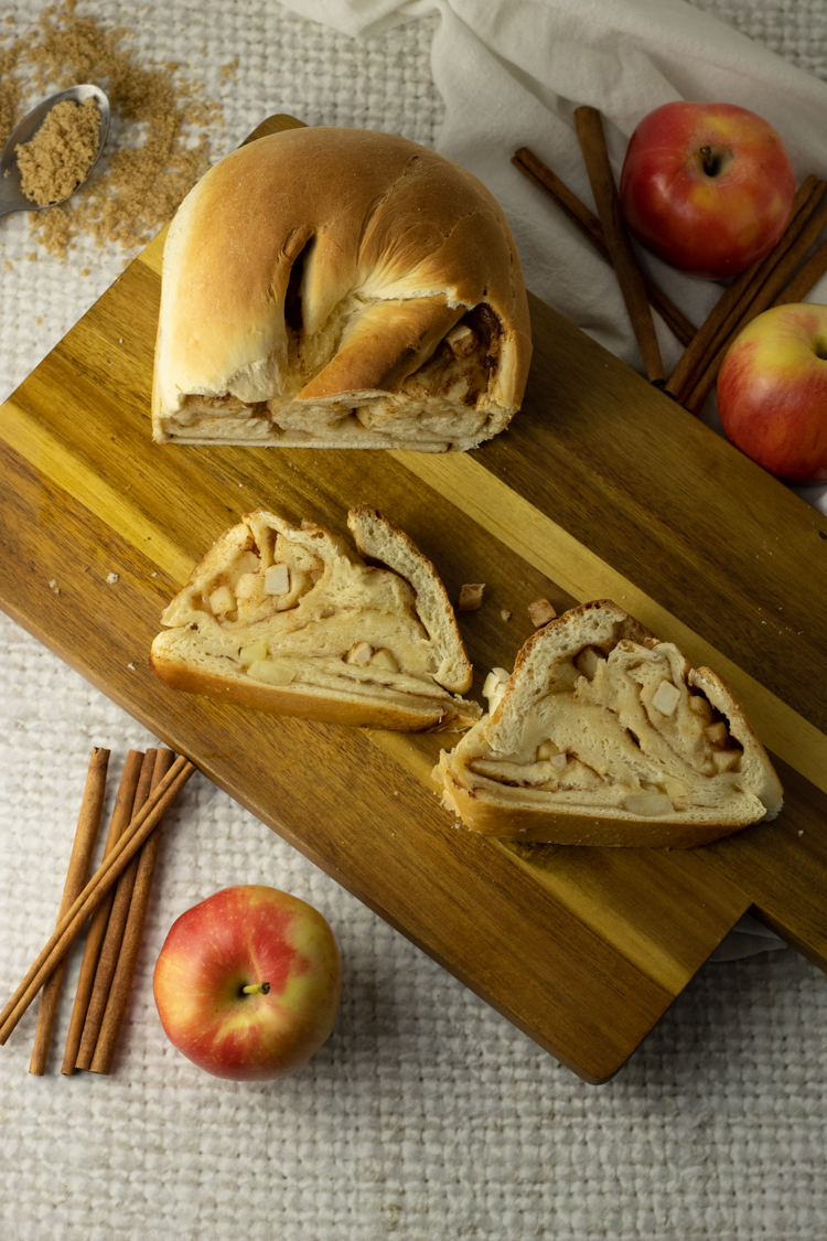 slices on apple bread on a wooden cutting board