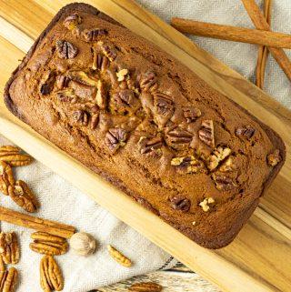 pumpkin bread on a wooden cutting board