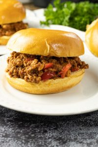 sloppy joe sandwich on a white plate