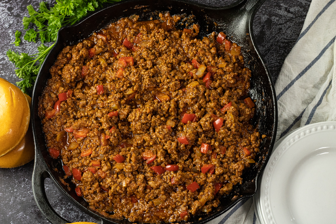 sloppy joe mix in a cast iron skillet