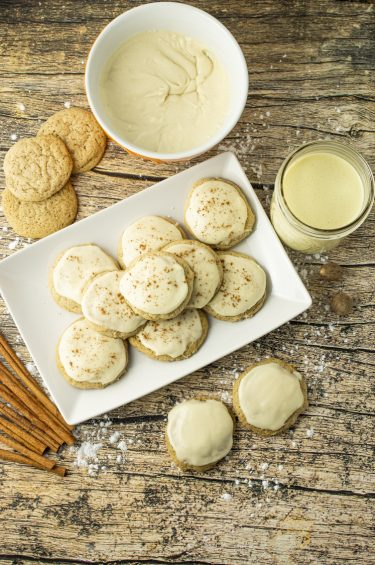 plate of eggnog cookies, with a cup of eggnog