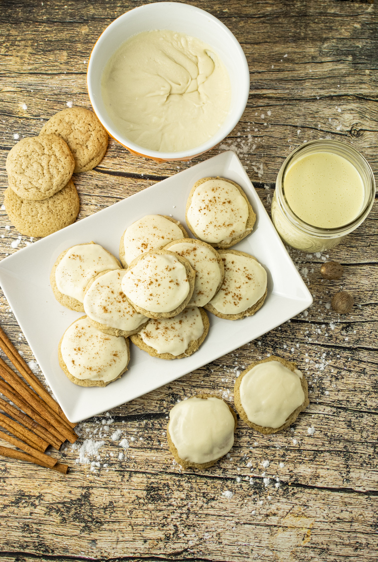 Eggnog Cookies are super soft, delicious cookies made with eggnog and loaded with delicious cinnamon and nutmeg flavor. This Eggnog Cookie recipe is simple to make and perfect for sharing with friends and family any time you can get your hands on some eggnog. The Eggnog frosting is the perfect topping for these festive cookies. #eggnog #eggnogrecipes #holidaybaking #holidayrecipes #cookieideas #christmascookies