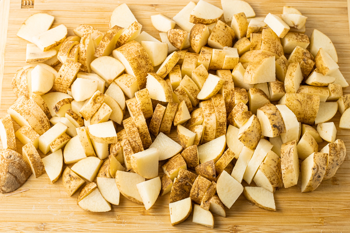 sliced potatoes on a wooden cutting board