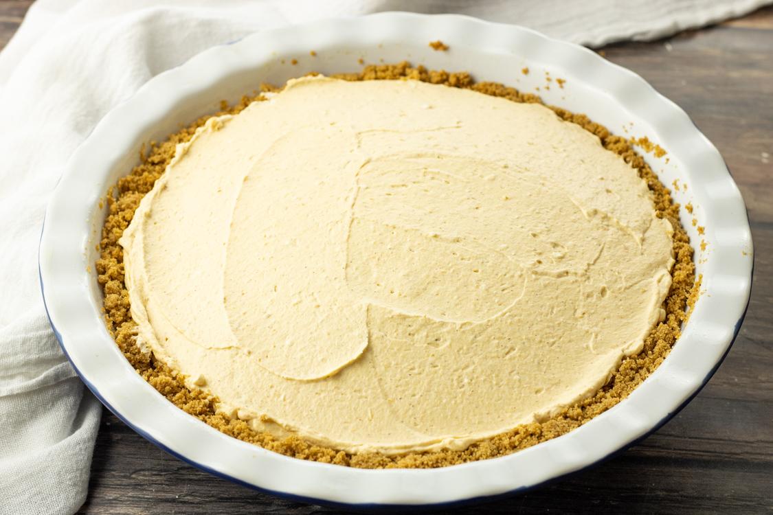 cream pumpkin pie in a graham cracker crust