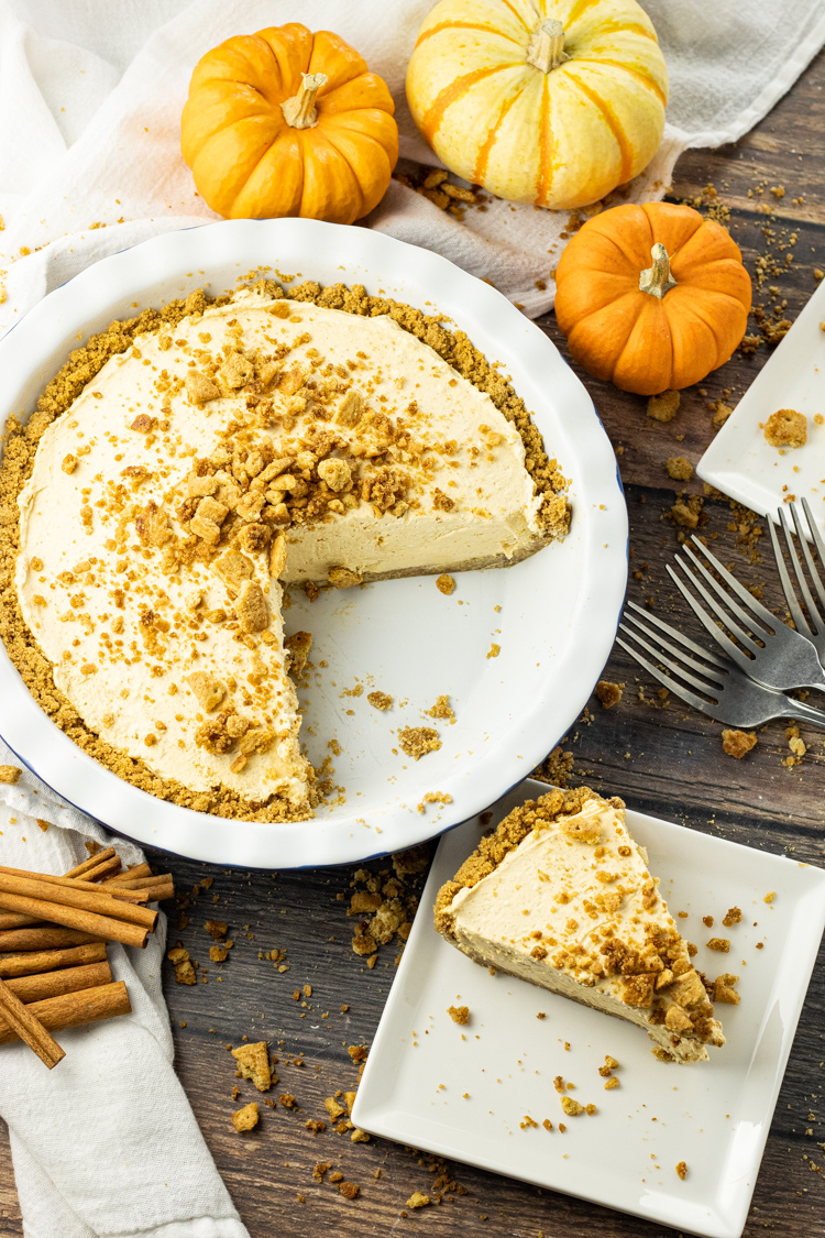 pumpkin cream pie with a slice taken out onto a plate