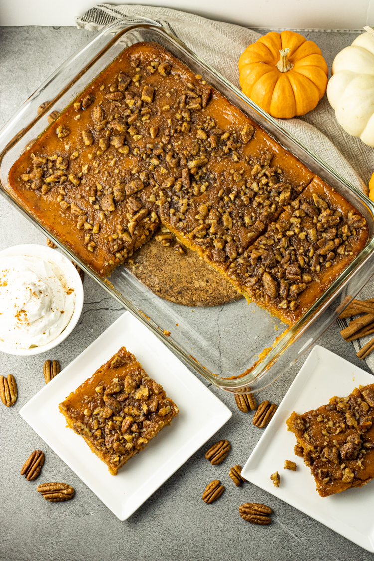 pumpkin pie bars sliced and on a white plate