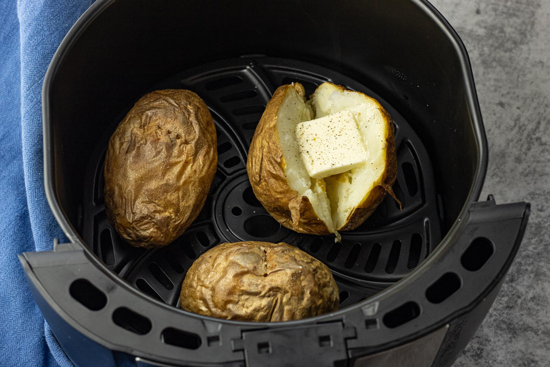 baked potatoes in an air fryer basket