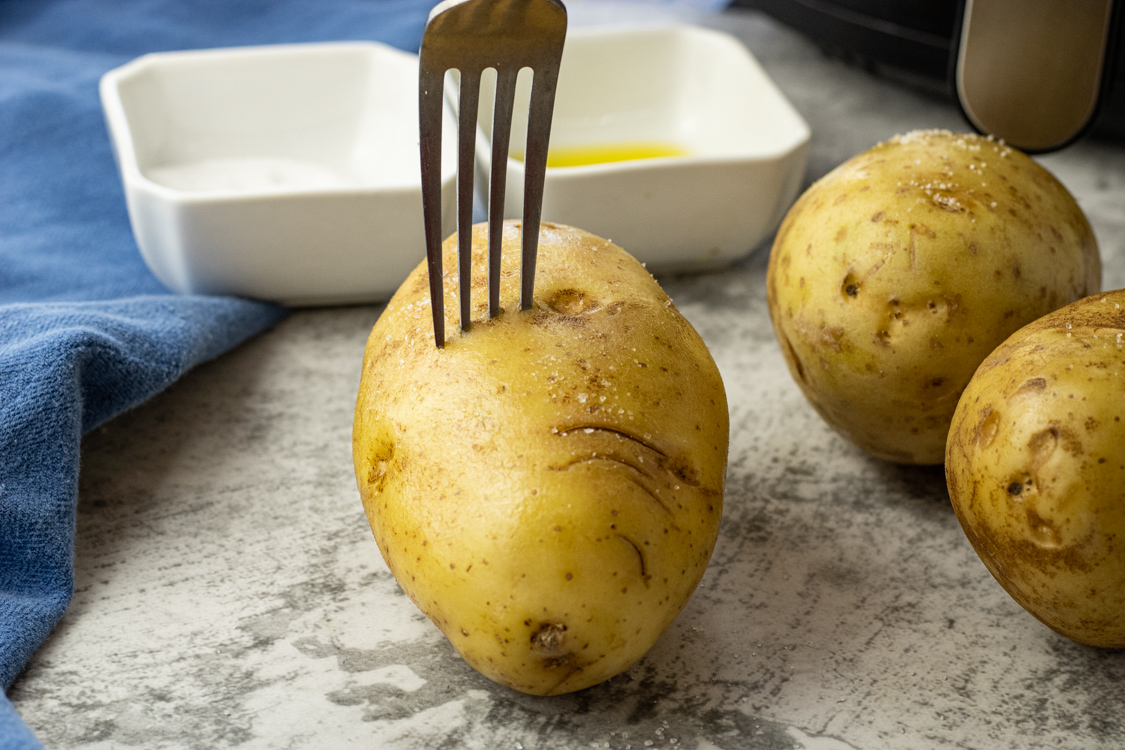 poking wholes in potatoes with a fork