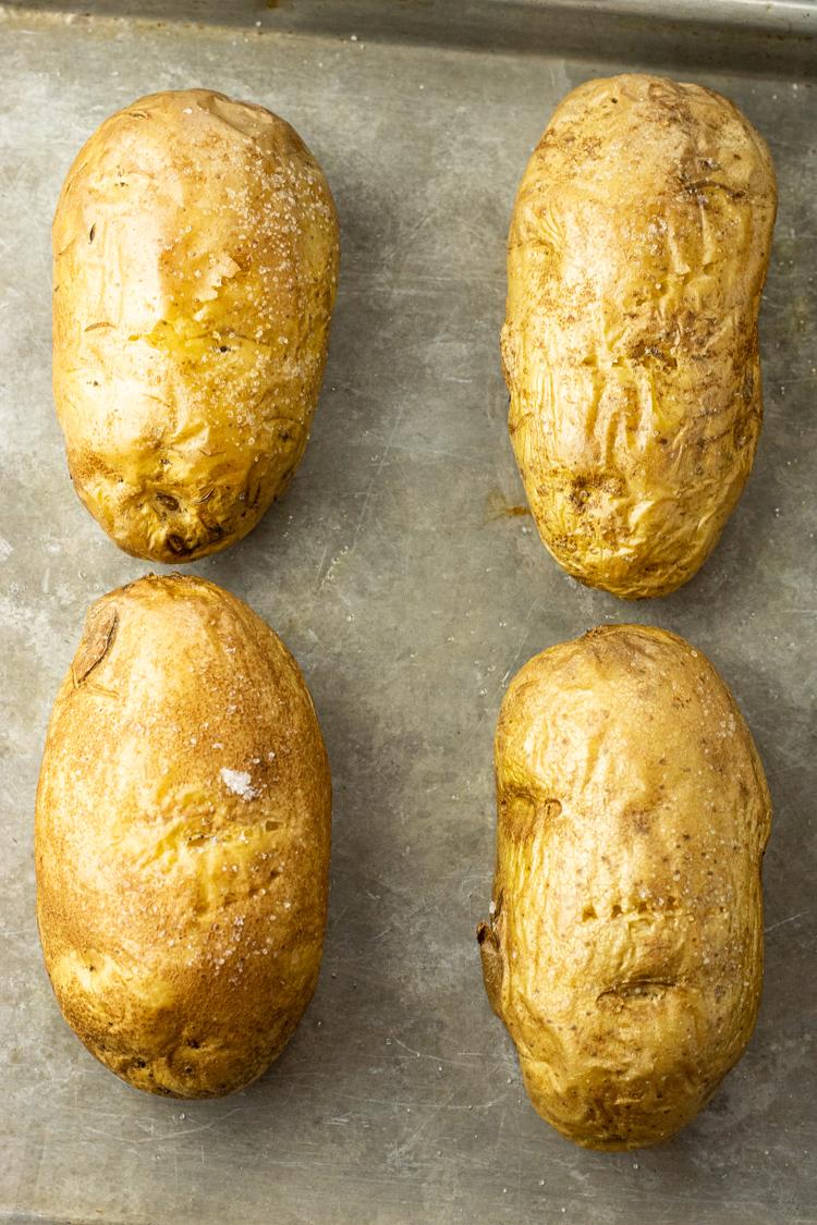 oven baked potatoes on a baking sheet