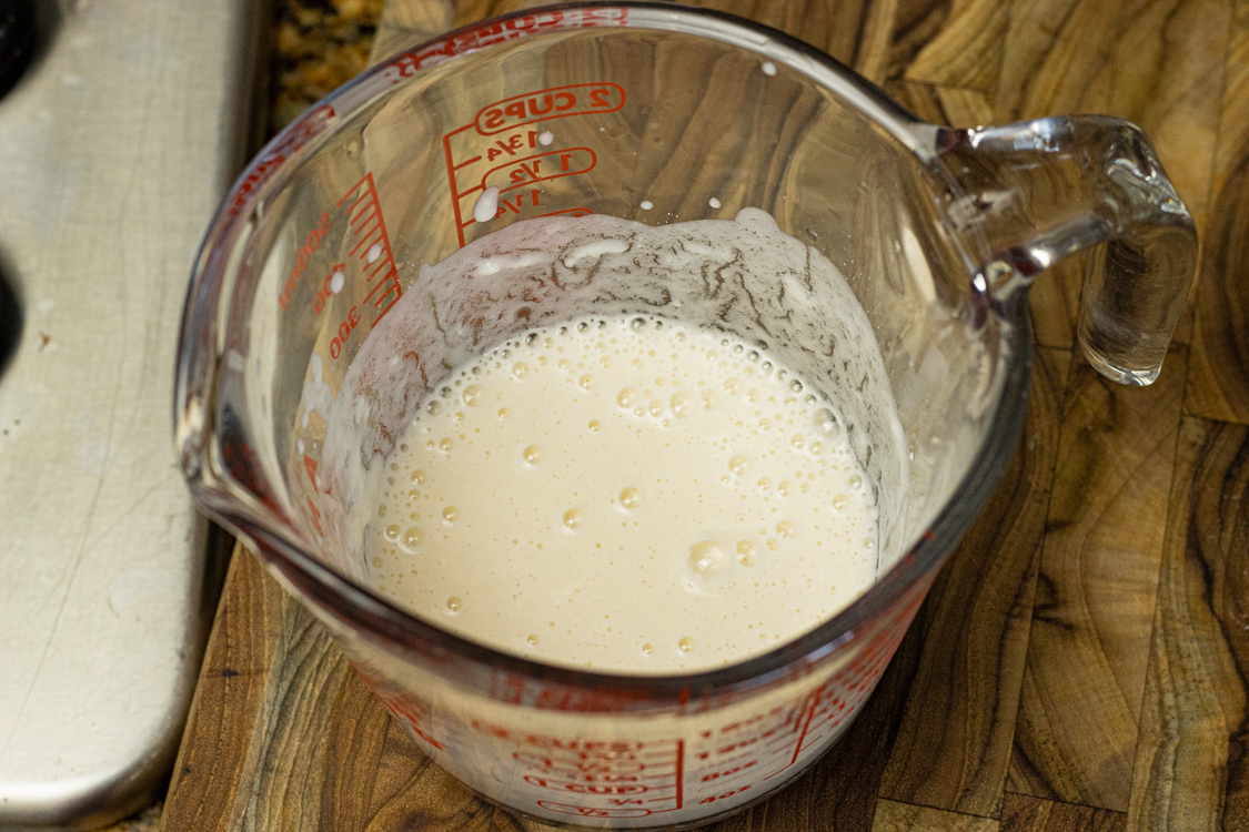 water and flour mixture in a measuring cup for thickening soup