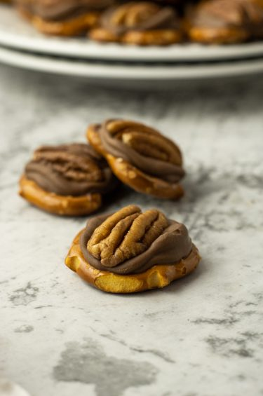 Rolo candies melted on pretzels then topped with a whole pecan