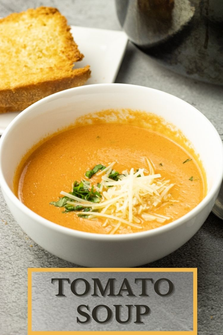 creamy tomato soup in a white bowl