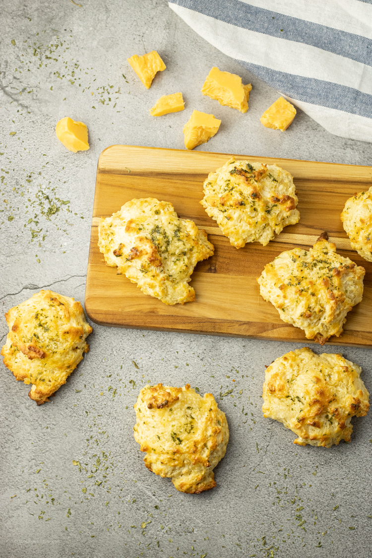 cheddar bay biscuits on a wooden platter