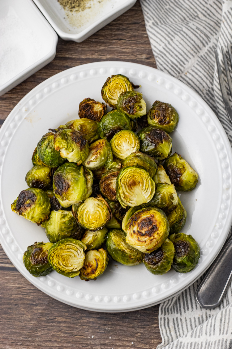 roasted brussel sprouts on a white plate