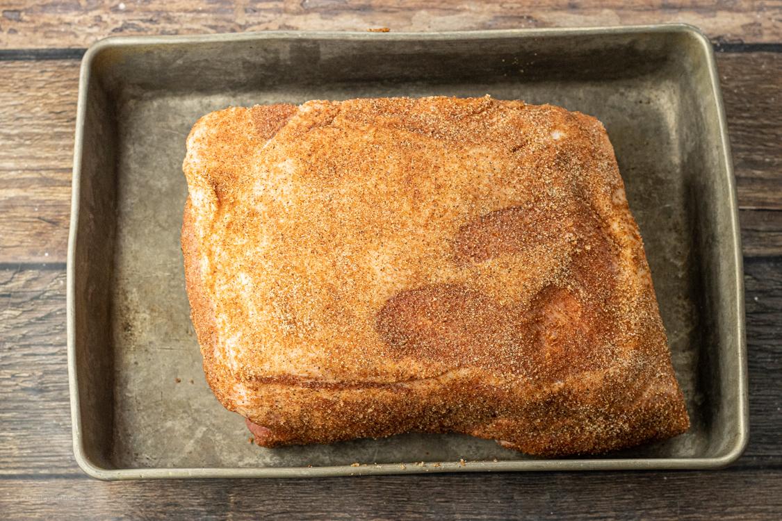 seasoned pork roast in a roasting pan