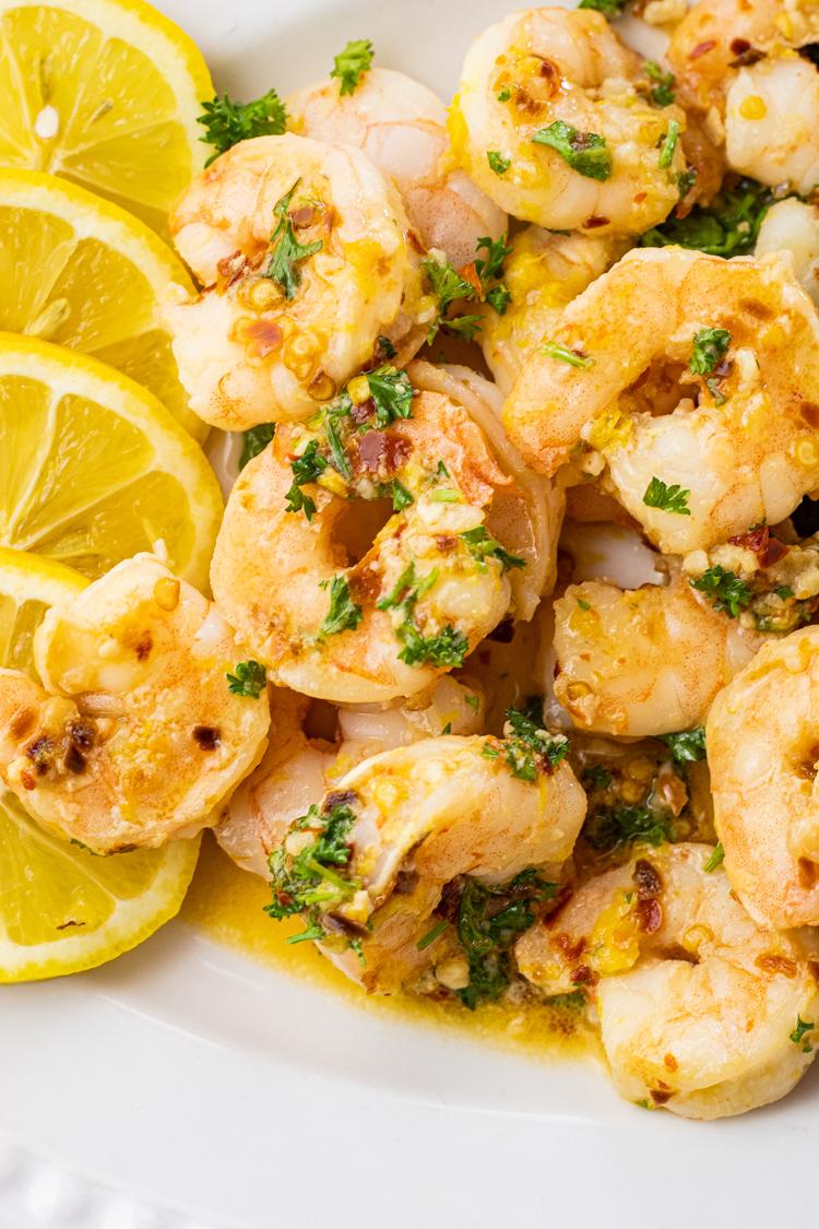 plate full of shrimp cooked in lemon and garlic