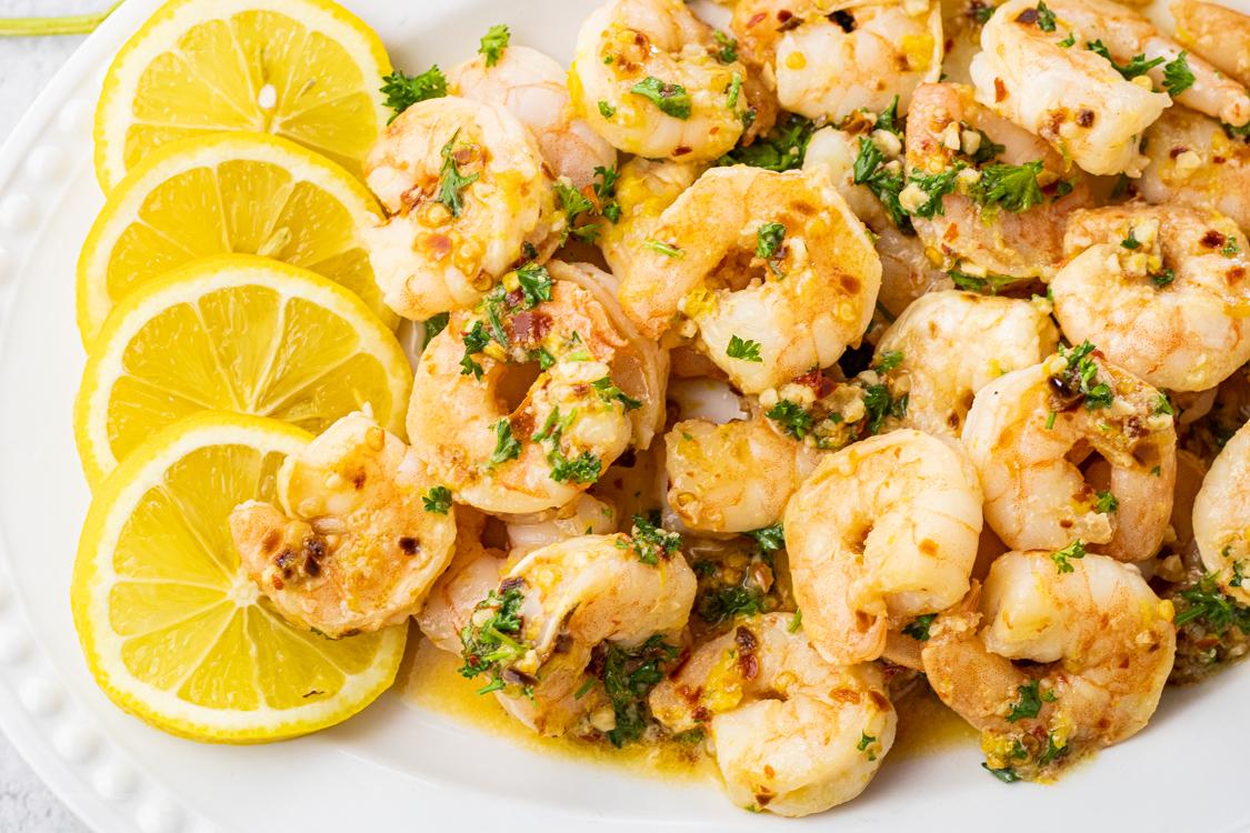 plate of shrimp covered with lemon garlic butter
