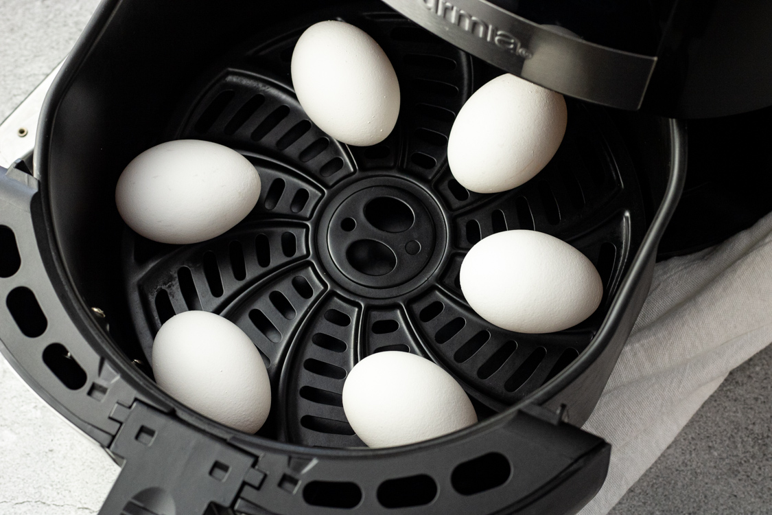eggs in the basket of an air fryer