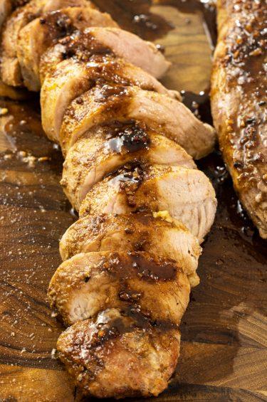 sliced pork tenderloin drizzled with balsamic vinegar