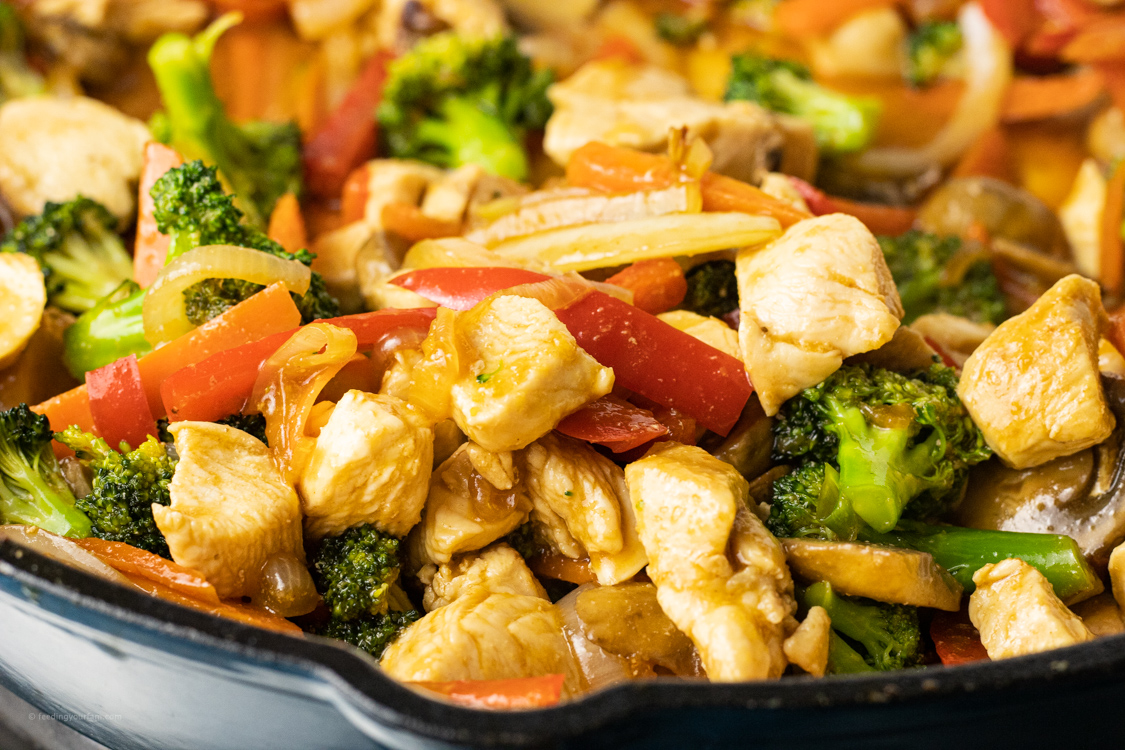 chicken stir fry in a large pan