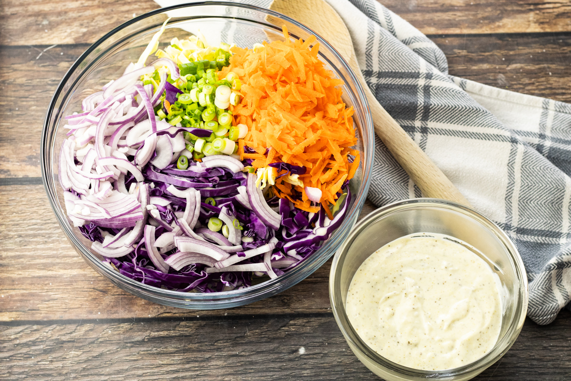 shredded cabbage, carrots and onions with coleslaw dressing