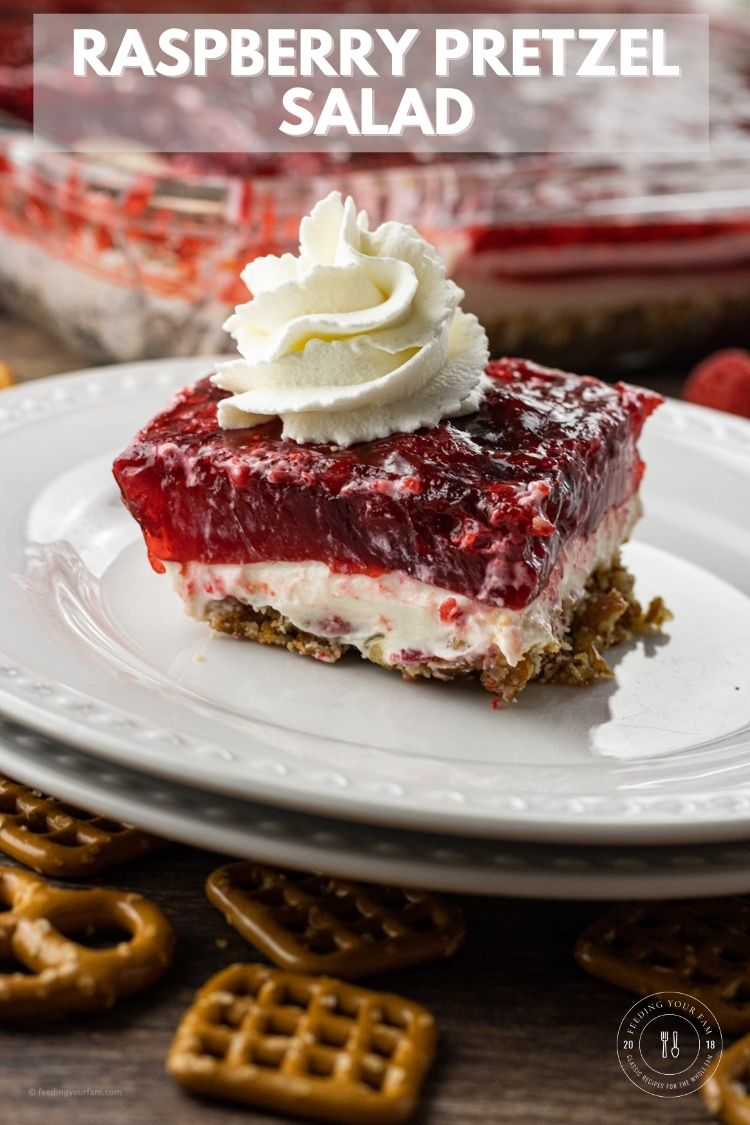 Raspberry Pretzel Salad is a potluck favorite. Layers of salty pretzels topped with a creamy cream cheese layer and raspberry jello with raspberries.